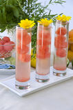 Watermelon cocktail drink. And yellow flowers Royalty Free Stock Photos
