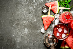Watermelon cocktail with ice in a shaker. On the stone table royalty free stock images