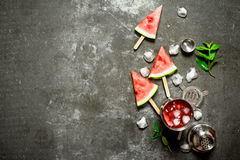 Watermelon cocktail with ice in a shaker. On the stone table royalty free stock photography