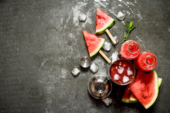 Watermelon cocktail with ice in a shaker. On the stone table royalty free stock photos