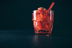 Watermelon cocktail with mint and straw in a red glass Royalty Free Stock Photo