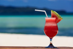 Watermelon cocktail on tropical beach Stock Photography