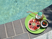 Watermelon and coconuts. Slice of Watermelon with kiwi and berries with cocnut water Stock Image