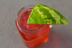 Watermelon Cooler. Watermelon wedge cocktail in a mason jar Royalty Free Stock Photos