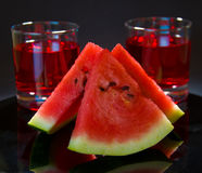 Watermelon and cordial Stock Images