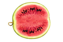 Watermelon Cross Section On White. Juicy red watermelon with black speyly bones cross section on white Stock Image