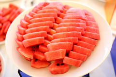 Watermelon cut in pieces in white dish. Royalty Free Stock Images