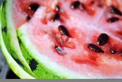 Watermelon cut slices macro detail close up, organic background texture. Top view royalty free stock photography