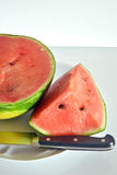 Watermelon cut into slices ready to eat. Closeup Stock Photo