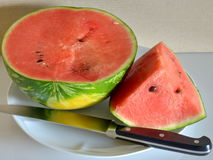 Watermelon cut into slices ready to eat. Closeup Royalty Free Stock Image