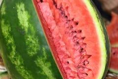 Watermelon cutout. Ripe watermelon cutout, pink pulp, striped rind stock photos
