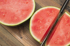 Watermelon. Cutting the  with knife Stock Photography