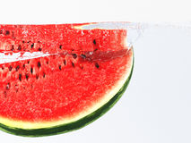 Watermelon. Falling into the water stock illustration