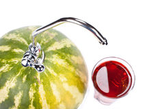Watermelon with faucet Royalty Free Stock Photography