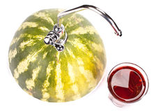 Watermelon with faucet Royalty Free Stock Images
