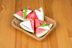 Watermelon with feta cheese and mint. On a wooden surface Stock Photos