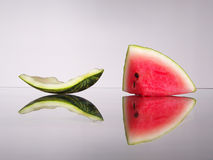 Watermelon fish. Fish-shaped watermelon on the reflective surface Royalty Free Stock Photo
