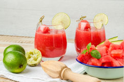 Watermelon fresh juice with mint leaves and lime citrus Stock Photography