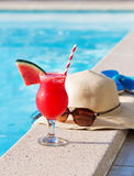 Watermelon fresh juice smoothie drink cocktail slippers, hat, sunglasses pool Royalty Free Stock Photo