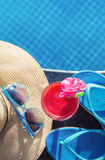 Watermelon fresh juice smoothie drink cocktail slippers, hat, sunglasses pool Stock Image