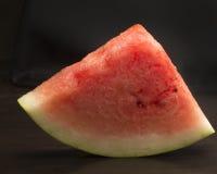 Watermelon. Fresh ripe watermelon on black background Royalty Free Stock Photo