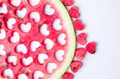 Watermelon fruit with heart shaped cut outs stock photography