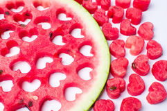 Watermelon fruit with heart shaped cut outs.  Stock Photo
