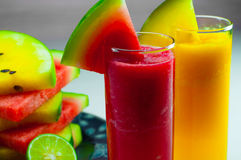 Watermelon fruit juice and fresh watermelon fruit Royalty Free Stock Image