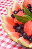 Watermelon Fruit Salad. Filled with frozen blueberries, watermelon balls and garnished with the herb Stevia Royalty Free Stock Image
