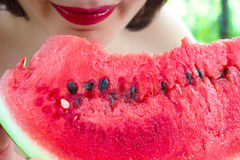 Watermelon - Fruit or Vegetable?. Young woman eating a red, ripe watermelon,photography Royalty Free Stock Image