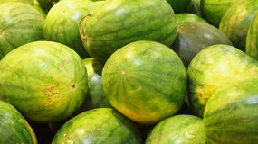 Watermelon fruits with selective focus and shallow depth of field. Royalty Free Stock Image