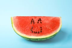 Watermelon with funny smiling face. On color background royalty free stock images