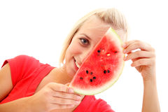 Watermelon girl. An attractive young girl with a slice of watermelon in front of her face Stock Images