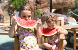 Watermelon Girls. Two little girls eating watermelon stock photography