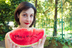 Watermelon for good health. Young woman eating a red, ripe watermelon,photography Royalty Free Stock Image