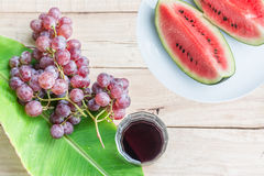 Watermelon and grape. On dry wood background Royalty Free Stock Photos