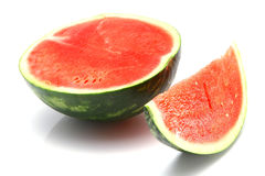 Watermelon half and slices Stock Images