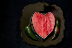 Watermelon heart with peppers Royalty Free Stock Photography