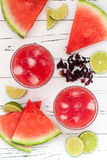 Watermelon, hibiscus, lime cooler - refreshing summer  drink with lime and mint. Royalty Free Stock Image