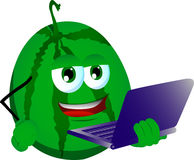 Watermelon holding laptop Royalty Free Stock Images