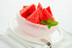 Watermelon in an ice bowl Stock Images