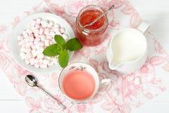 Watermelon Jam, Herbal Tea, Marshmallows. White Wooden Table. Royalty Free Stock Photos