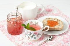 Watermelon Jam, Herbal Tea, Marshmallows. White Wooden Table. Stock Photo