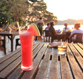 Fresh cold watermelon juice on the beach, open air cafe. Watermelon juice with straw and watermelon slice. Malaysia, Pangkor island Royalty Free Stock Photo
