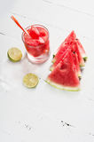 Watermelon juice with lime citrus on wood Royalty Free Stock Photos