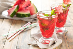 Watermelon juice. Watermelon juice with mint and ice on wooden rustic  table Royalty Free Stock Photo