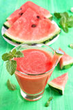 Watermelon juice and slices Royalty Free Stock Photos