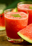 Watermelon juice on a wooden table Royalty Free Stock Photography