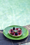 Watermelon. With kiwi and berries  by the pool Royalty Free Stock Image