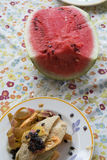 Watermelon and leftovers after the lunch Royalty Free Stock Photography